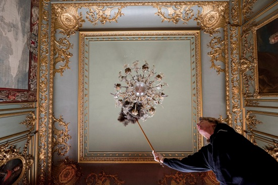 08/01/2016 BLENHEIM PALACE Blenheim Palace deep clean 2016. Christine Dittmers carefully cleans the chandelier in the 3rd state room in Blenheim Palace. Photographer : Mark Hemsworth